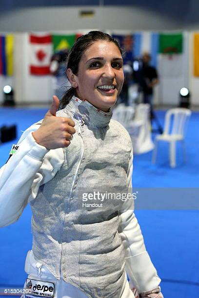 In this handout image provided by the International Fencing Federation Arianna Errigo of Italy celebrates winning the women's foil event at the...