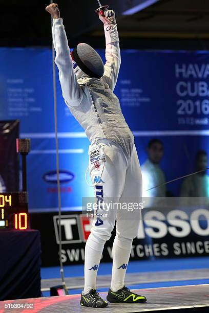 In this handout image provided by the International Fencing Federation Arianna Errigo of Italy celebrates winning the women's foil event against Lee...