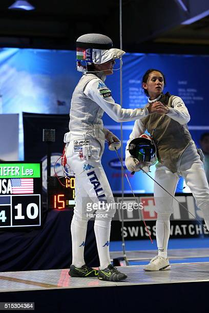 In this handout image provided by the International Fencing Federation Lee Kiefer of USA congratulates Arianna Errigo of Italy for winning the final...