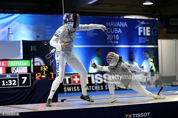 In this handout image provided by the International Fencing Federation USA fencer Lee Kiefer attempts to make a comeback against Italy's Arianna...