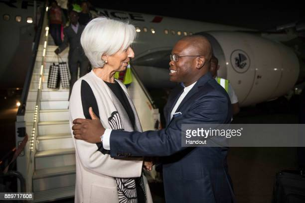 In this handout image provided by the International Monetary Fund International Monetary Fund Managing Director Christine Lagarde is greeted by...