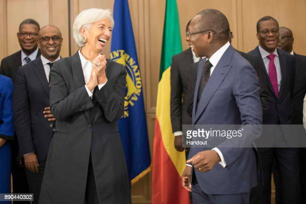In this handout image provided by the International Monetary Fund International Monetary Fund Managing Director Christine Lagarde is greeted by Benin...