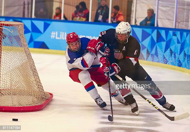 In this handout image provided by the IOC Anton Malyshev of Russia and Adam Samuelsson of the United States battle for the puck during the Men's Ice...