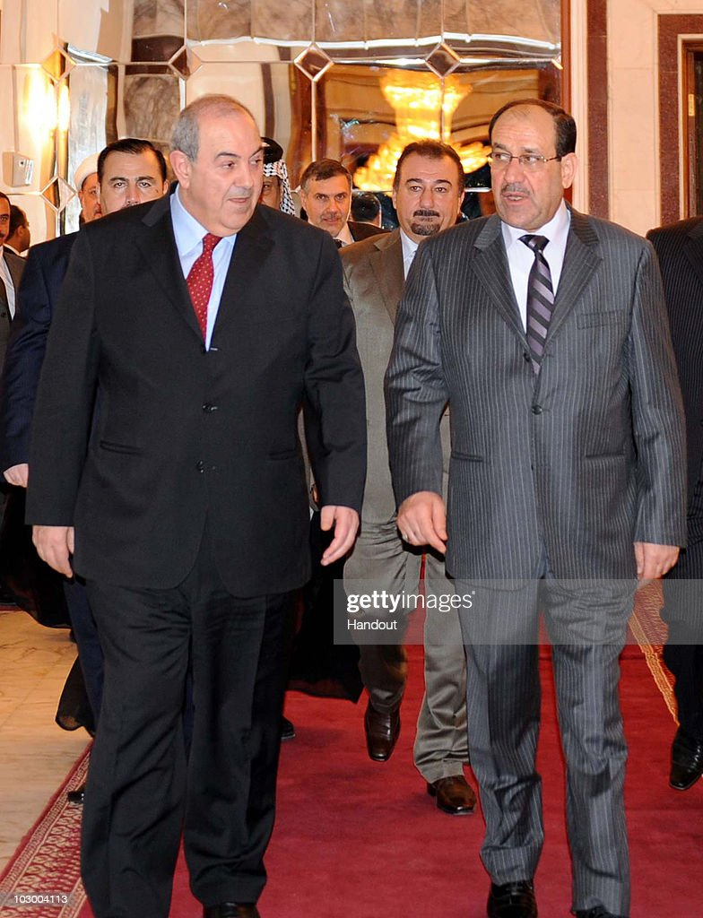 In this handout image provided by the Iraqi Prime Minister office shows Iraqi Prime Minister Nuri al-Maliki (R) speaking with Iraq' s former Prime Minister Iyad Allawi (L) during a meeting on July 20, 2010 in Baghdad, Iraq. The two met to discuss the formation of a new Iraqi government.