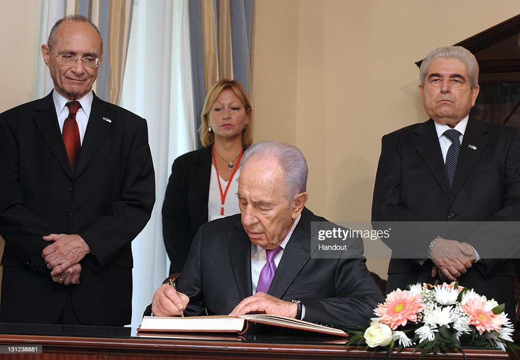 In this handout image provided by the Israeli Government Press Office (GPO) Israeli Minister Uzi Landau, (L) Israeli President <a gi-track='captionPersonalityLinkClicked' href=/galleries/search?phrase=Shimon+Peres&family=editorial&specificpeople=201775 ng-click='$event.stopPropagation()'>Shimon Peres</a> (C) and Cyprus President Demetris Christofias (R) sign an economic agreement on November 3, 2011 in Nicosia, Cyprus. President Peres was in Cyprus to for talks on energy deals and the reunification of Cyprus.