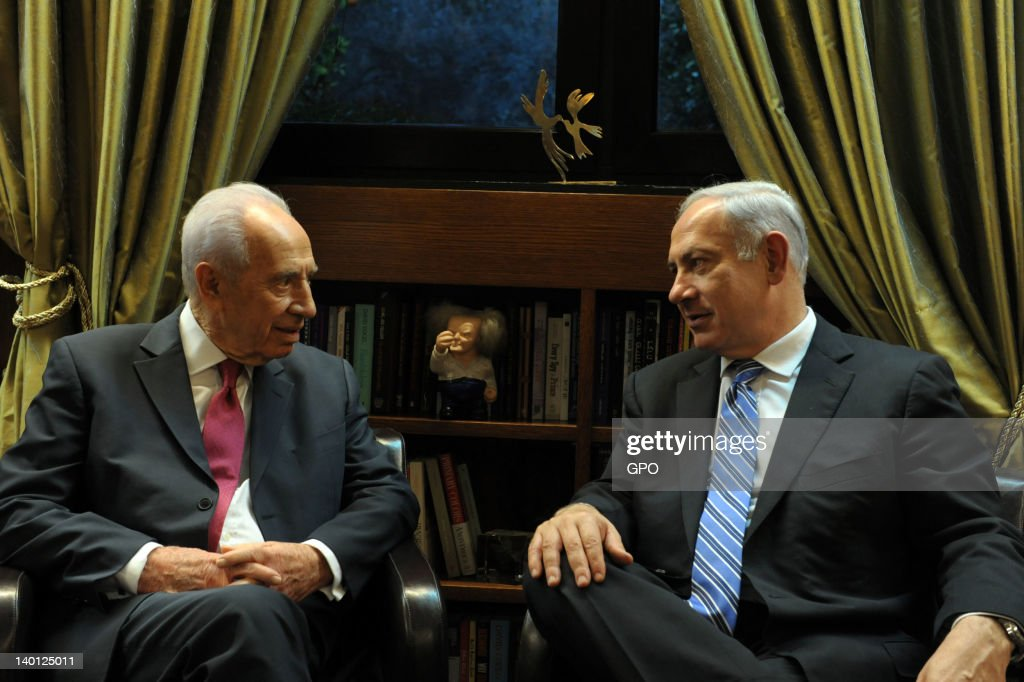 In this handout image provided by the Israeli Government Press Office (GPO), Israeli President <a gi-track='captionPersonalityLinkClicked' href=/galleries/search?phrase=Shimon+Peres&family=editorial&specificpeople=201775 ng-click='$event.stopPropagation()'>Shimon Peres</a> and Israeli Prime Minister Benyamin Netanyahu are pictured at the President's Residence on February 28, 2011 in Jerusalem, Israel. The Israeli PM and President will fly to Washingtom for a meeting with US President Barack Obama on March 5, as tension increase over Iran's nuclear program.