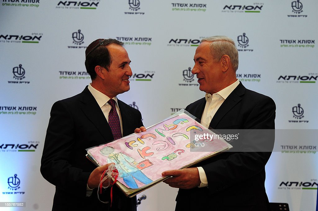 In this handout image provided by the Israeli Government Press Office (GPO), Israeli Prime Minister <a gi-track='captionPersonalityLinkClicked' href=/galleries/search?phrase=Benjamin+Netanyahu&family=editorial&specificpeople=118594 ng-click='$event.stopPropagation()'>Benjamin Netanyahu</a> (R) attends a cornerstone-laying ceremony for a hospital November 8, 2012 in the southern city of Ashdod, Israel. Netanyahu has faced criticism from political rivals this week that he favored Republican nominee Mitt Romney in the U.S. presidential election over President Barack Obama.