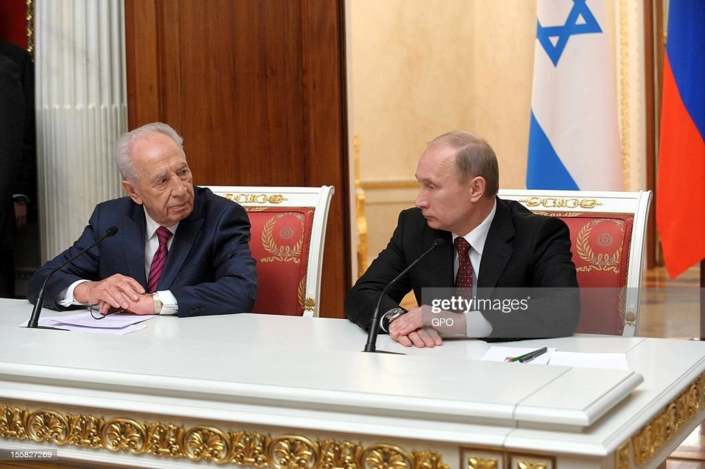 In this handout image provided by the Israeli Government Press Office (GPO), Russia's President <a gi-track='captionPersonalityLinkClicked' href=/galleries/search?phrase=Vladimir+Putin&family=editorial&specificpeople=154896 ng-click='$event.stopPropagation()'>Vladimir Putin</a> (R) and his Israeli counterpart <a gi-track='captionPersonalityLinkClicked' href=/galleries/search?phrase=Shimon+Peres&family=editorial&specificpeople=201775 ng-click='$event.stopPropagation()'>Shimon Peres</a> attend a joint press conference at the Kremlin on November 8, 2012 in Moscow, Russia.