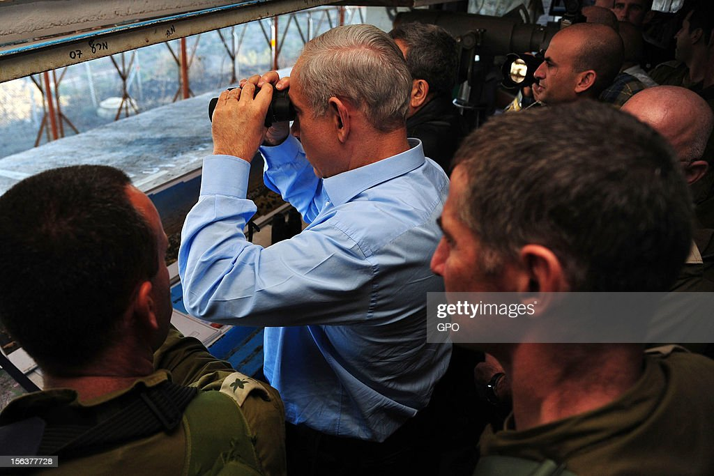 In this handout image provided by the Israeli Government Press Office (GPO), Israeli Prime Minister <a gi-track='captionPersonalityLinkClicked' href=/galleries/search?phrase=Benjamin+Netanyahu&family=editorial&specificpeople=118594 ng-click='$event.stopPropagation()'>Benjamin Netanyahu</a> (2L) and Defence Minister <a gi-track='captionPersonalityLinkClicked' href=/galleries/search?phrase=Ehud+Barak&family=editorial&specificpeople=202888 ng-click='$event.stopPropagation()'>Ehud Barak</a> (3L, obscured) visit the northern border with Syria November 14, 2012 in Israel. Netanyahu asserted that Israel would defend its border as the Syrian civil war threatened to destabilize the region.