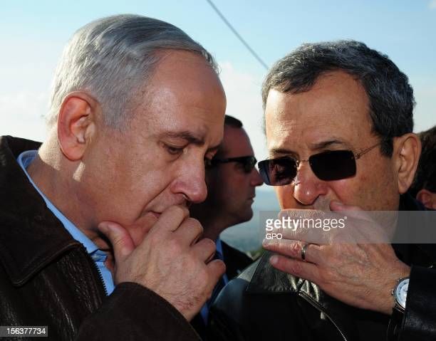 In this handout image provided by the Israeli Government Press Office Israeli Prime Minister Benjamin Netanyahu and Defence Minister Ehud Barak visit...