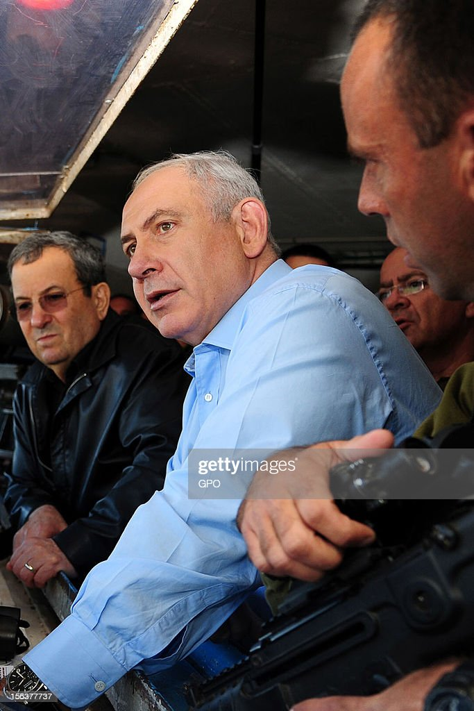 In this handout image provided by the Israeli Government Press Office (GPO), Israeli Prime Minister Benjamin Netanyahu (2L) and Defence Minister Ehud Barak (L) visit the northern border with Syria November 14, 2012 in Israel. Netanyahu asserted that Israel would defend its border as the Syrian civil war threatened to destabilize the region.