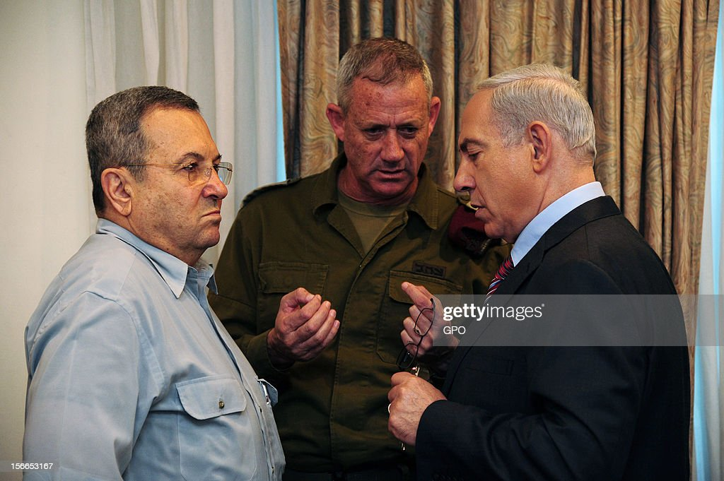 In this handout image provided by the Israeli Government Press Office (GPO), Prime Minister <a gi-track='captionPersonalityLinkClicked' href=/galleries/search?phrase=Benjamin+Netanyahu&family=editorial&specificpeople=118594 ng-click='$event.stopPropagation()'>Benjamin Netanyahu</a> speaks with IDF Chief of Staff Lt.-Gen. Benny Gantz (C) and Defence Minister <a gi-track='captionPersonalityLinkClicked' href=/galleries/search?phrase=Ehud+Barak&family=editorial&specificpeople=202888 ng-click='$event.stopPropagation()'>Ehud Barak</a> ahead of the weekly cabinet meeting on November 18, 2012 in Jerusalem. Israel. Israeli shelling of Gaza has entered its fifth day, with two media buildings being recently struck and several journalists injured. According to health officials in Gaza, at least 50 Palestinians have been killed since Israel launched operation Pillar of Defence. So far three Israelis have died in the exchange of missiles which followed an air strike on Wednesday that killed Hamas military chief Ahmed Jabari.