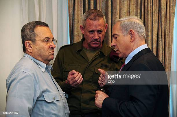 In this handout image provided by the Israeli Government Press Office Prime Minister Benjamin Netanyahu speaks with IDF Chief of Staff LtGen Benny...