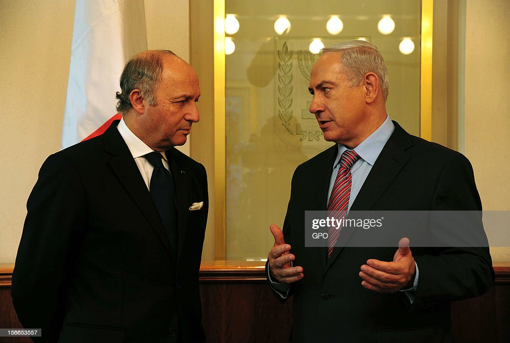 In this handout image provided by the Israeli Government Press Office (GPO), Prime Minister Benjamin Netanyahu (R) meets with French Foreign Minister <a gi-track='captionPersonalityLinkClicked' href=/galleries/search?phrase=Laurent+Fabius&family=editorial&specificpeople=540660 ng-click='$event.stopPropagation()'>Laurent Fabius</a> at the Prime Minister's offices on November 18, 2012 in Jerusalem. Israel. Israeli shelling of Gaza has entered its fifth day, with two media buildings being recently struck and several journalists injured. According to health officials in Gaza, at least 50 Palestinians have been killed since Israel launched operation Pillar of Defence. So far three Israelis have died in the exchange of missiles which followed an air strike on Wednesday that killed Hamas military chief Ahmed Jabari.