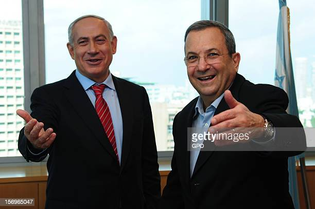 In this handout image provided by the Israeli Government Press Office Prime Minister Benjamin Netanyahu and Defence Minister Ehud Barak gesture and...