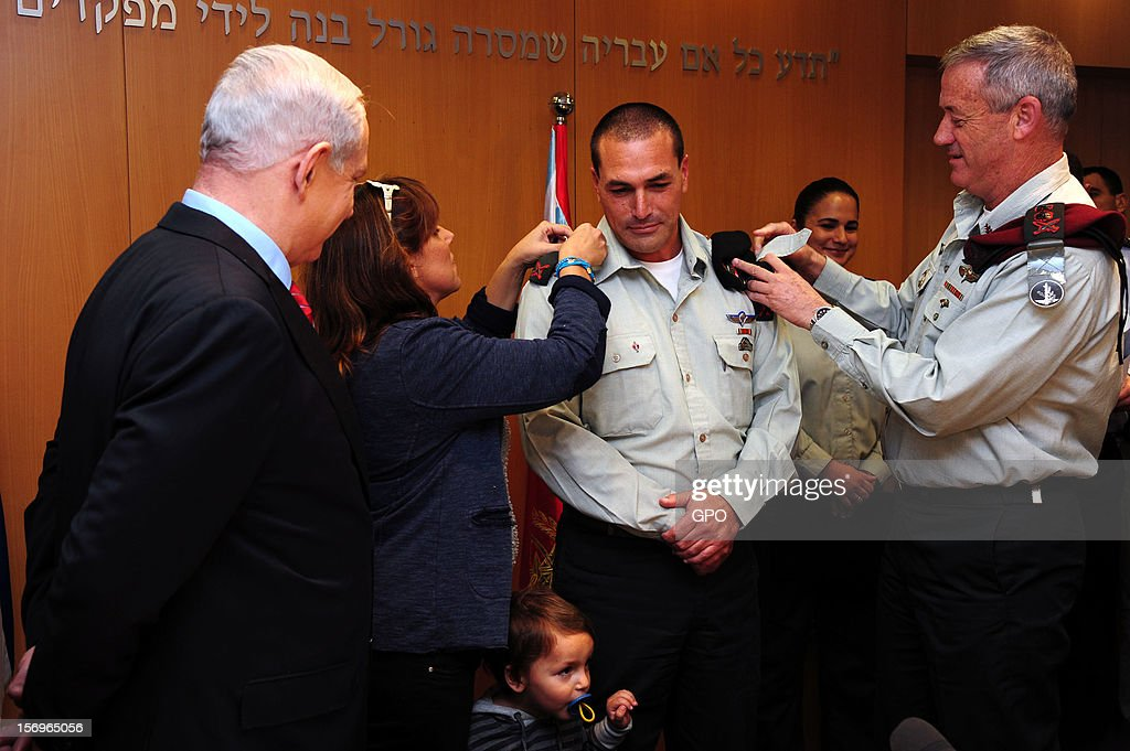 In this handout image provided by the Israeli Government Press Office (GPO), Prime Minister Benjamin Netanyahu (L) looks on as IDF Chief of Staff Lt.-Gen. Benny Gantz (R) adjusts the epaulettes on Brig. Gen. Eyal Zamir ,as he is appointed the new military secretary, on November 26, 2012 in Tel Aviv, Israel. The appointment comes following eight days of conflict with Hamas.