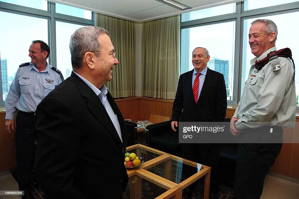 In this handout image provided by the Israeli Government Press Office (GPO), Prime Minister Benjamin Netanyahu (2nd R), Defence Minister Ehud Barak (2nd L), outgoing military secretary Yohanan Locker (L), and IDF Chief of Staff Lt.-Gen. Benny Gantz (R) share a laugh as Brig. Gen. Eyal Zamir (not pictured) is appointed the new military secretary, on November 26, 2012 in Tel Aviv, Israel. The appointment comes following eight days of conflict with Hamas.