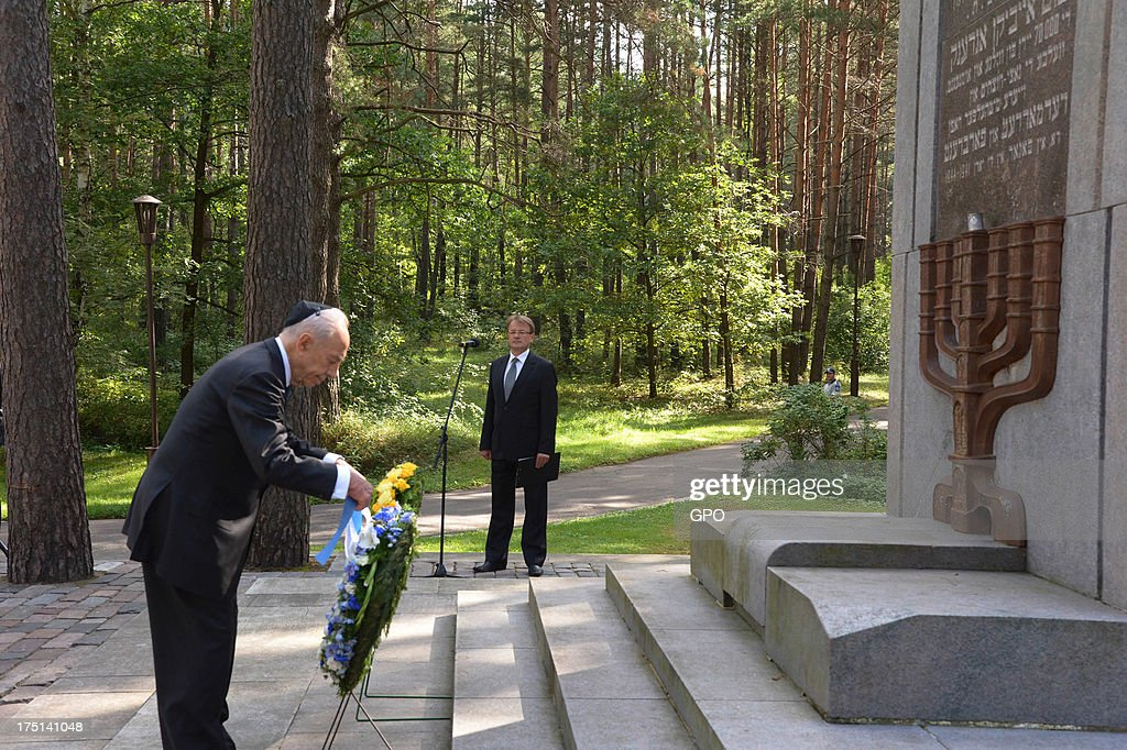 In this handout image provided by the Israeli Government Press Office (GPO), Israeli President Shimon Peres lays a wreath at the foot of the Paneriai Memorial during a remembrance ceremony on August 01, 2013 in Paneriai near Vilnius, Lithuania. Israel's president Shimon Peres and Lithuania's President Dalia Grybauskaite attended a ceremony of remembrance for around 100,000 victims, over half of whom were Jewish, of the massacre that took place at the site by Nazis and a group of Lithuanians from organisations such as the Vilnius Special Squad between July 1941 and August 1944 during World War II.