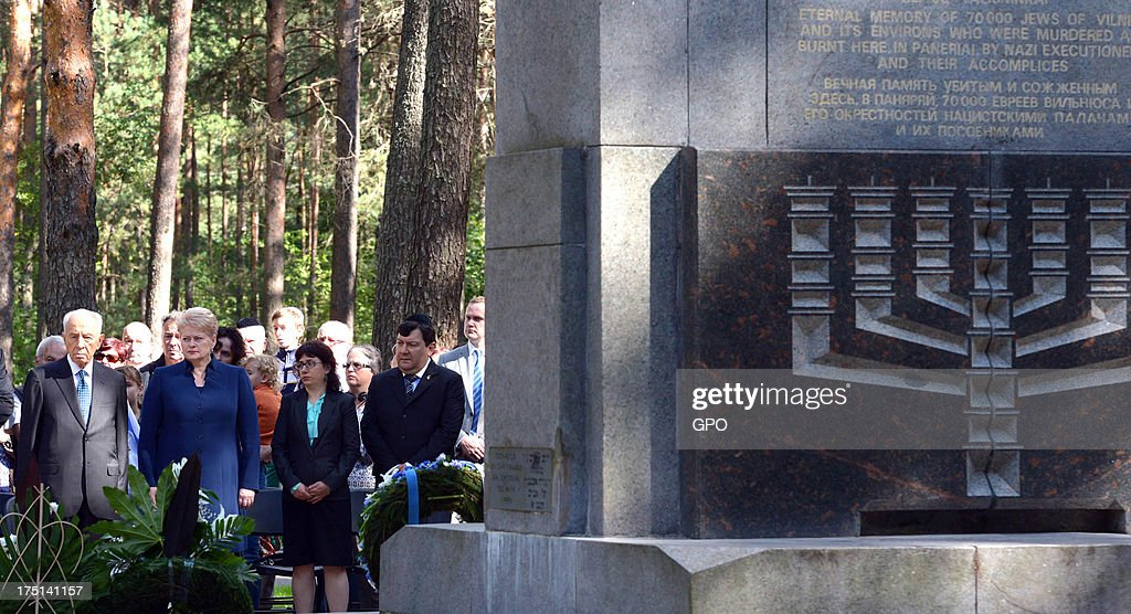 In this handout image provided by the Israeli Government Press Office (GPO), Israeli President Shimon Peres (L) and Lithuania's President Dalia Grybauskaite (2nd L) attend a remembrance ceremony at Paneriai Memorial on August 01, 2013 in Paneriai near Vilnius, Lithuania. Israel's president Shimon Peres and Lithuania's President Dalia Grybauskaite attended a ceremony of remembrance for around 100,000 victims, over half of whom were Jewish, who were murdered at the site by German Nazis and Lithuanian groups from organisations such as the Vilnius Special Squad between July 1941 and August 1944 during World War II.