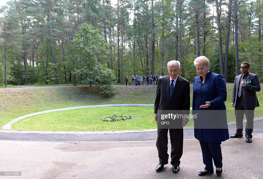 In this handout image provided by the Israeli Government Press Office (GPO), Israeli President Shimon Peres and Lithuania's President Dalia Grybauskaite (front R) attend a remembrance ceremony at Paneriai Memorial on August 01, 2013 in Paneriai near Vilnius, Lithuania. Israel's president Shimon Peres and Lithuania's President Dalia Grybauskaite attended a ceremony of remembrance for around 100,000 victims, over half of whom were Jewish, who were murdered at the site by German Nazis and Lithuanian groups from organisations such as the Vilnius Special Squad between July 1941 and August 1944 during World War II.