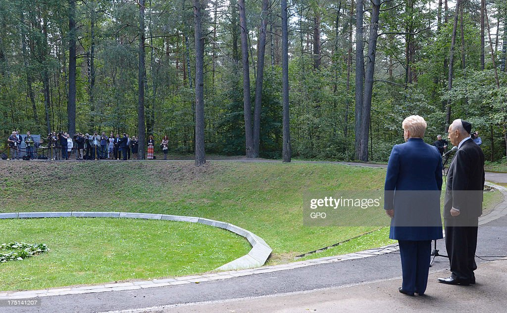 In this handout image provided by the Israeli Government Press Office (GPO), Israeli President Shimon Peres (R) and Lithuania's President Dalia Grybauskaite attend a remembrance ceremony at Paneriai Memorial on August 01, 2013 in Paneriai near Vilnius, Lithuania. Israel's president Shimon Peres and Lithuania's President Dalia Grybauskaite attended a ceremony of remembrance for around 100,000 victims, over half of whom were Jewish, who were murdered at the site by German Nazis and Lithuanian groups from organisations such as the Vilnius Special Squad between July 1941 and August 1944 during World War II.