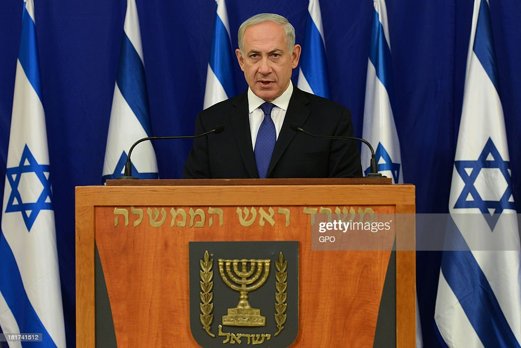 In this handout image provided by the Israeli Government Press Office (GPO), Prime Minister <a gi-track='captionPersonalityLinkClicked' href=/galleries/search?phrase=Benjamin+Netanyahu&family=editorial&specificpeople=118594 ng-click='$event.stopPropagation()'>Benjamin Netanyahu</a> delivers a press statement at his office, following U.S. President Barack Obama's speech at the United Nations, on September 24, 2013 in Tel Aviv, Israel. Netanyahu will address the UN general assembly on October 1.