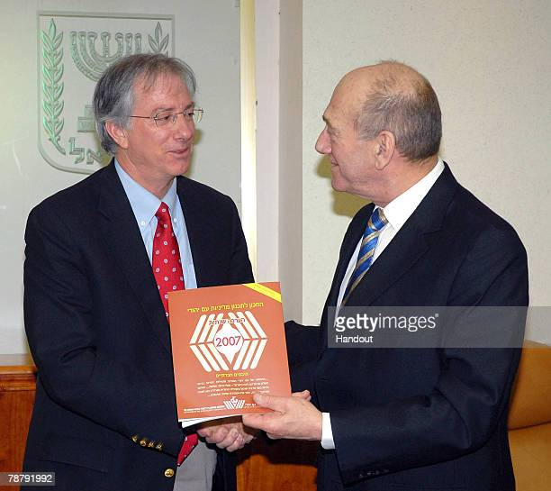 In this handout image provided by the Israeli Government Press Office Israeli Prime Minister Ehud Olmert receives the Jewish People Policy Planning...