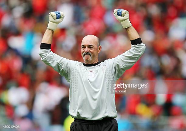 In this handout image provided by the ITM Group Bruce Grobbelaar celebrates during the Legends match between Liverpool FC Legends and Kaizer Chiefs...