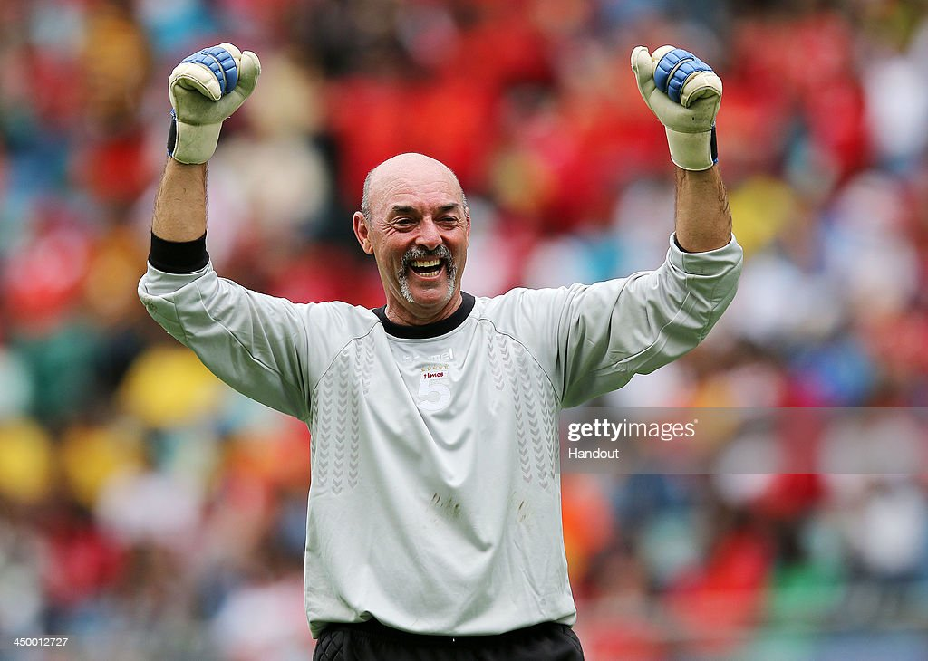 In this handout image provided by the ITM Group, Bruce Grobbelaar celebrates during the Legends match between Liverpool FC Legends and Kaizer Chiefs Legends at Moses Mabhida Stadium on November 16, 2013 in Durban, South Africa.