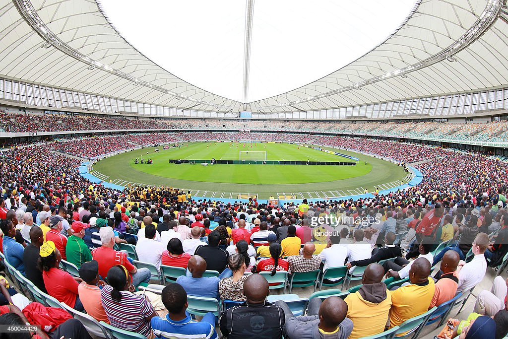 In this handout image provided by the ITM Group, Fans enjoy the game during the Legends match between Liverpool FC Legends and Kaizer Chiefs Legends at Moses Mabhida Stadium on November 16, 2013 in Durban, South Africa.