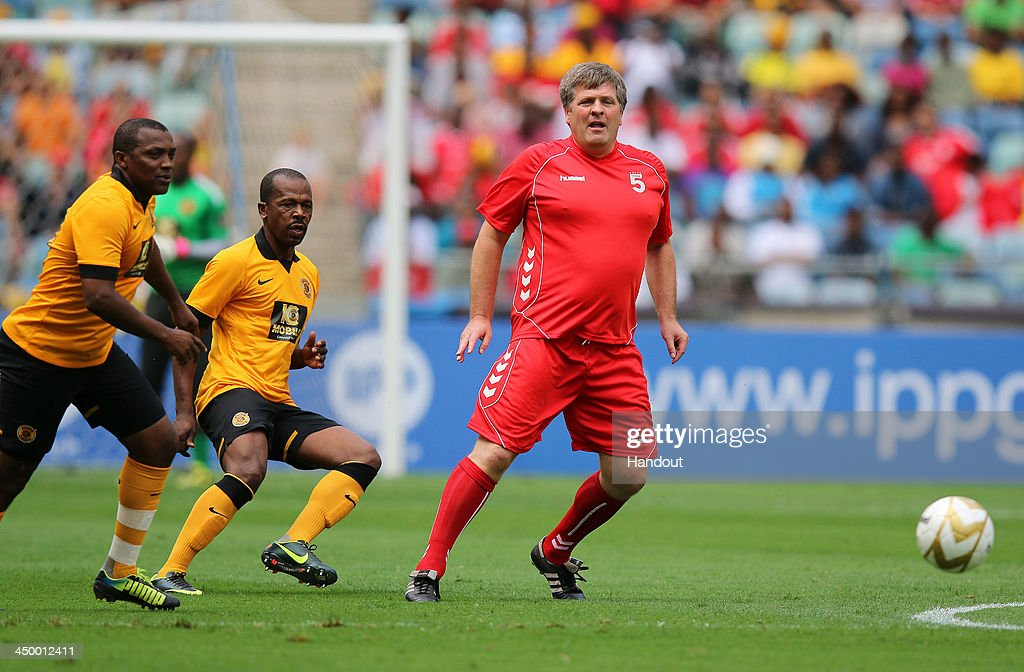 In this handout image provided by the ITM Group, Jan Molby of Liverpool passes the ball back during the Legends match between Liverpool FC Legends and Kaizer Chiefs Legends at Moses Mabhida Stadium on November 16, 2013 in Durban, South Africa.