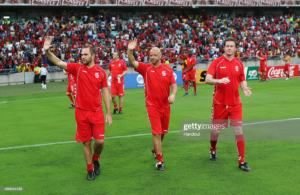 In this handout image provided by the ITM Group, (L-R) Jason McAteer, Rob Jones and Steve McManaman of Liverpool FC Legends during the Legends match between Liverpool FC Legends and Kaizer Chiefs Legends at Moses Mabhida Stadium on November 16, 2013 in Durban, South Africa.