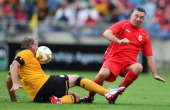 In this handout image provided by the ITM Group John Aldridge kicks the ball into Neil Tovey during the Legends match between Liverpool FC Legends...