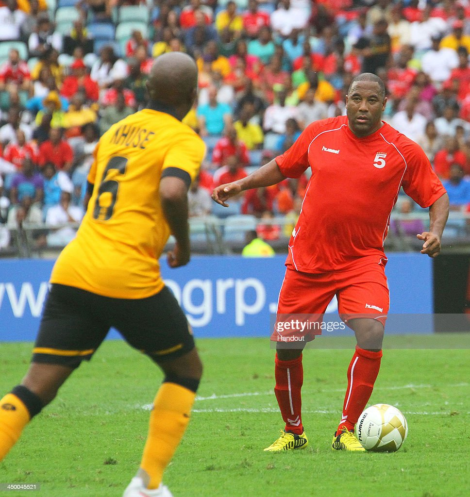 In this handout image provided by the ITM Group, John Barnes of Liverpool FC Legends on the ball during the Legends match between Liverpool FC Legends and Kaizer Chiefs Legends at Moses Mabhida Stadium on November 16, 2013 in Durban, South Africa.