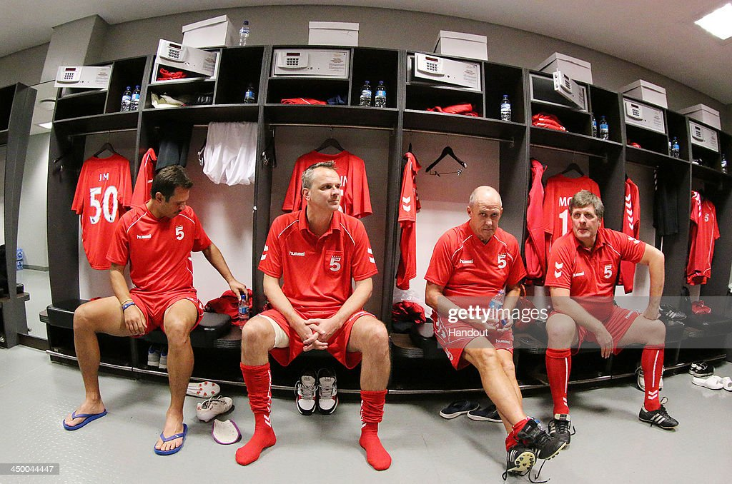 In this handout image provided by the ITM Group, (L-R) Patrik Berger (L), Dietmar Hamman (2nd, L), Phil Neal and Jan Molby of Liverpool FC Legends (R) sit in the dressing room during the Legends match between Liverpool FC Legends and Kaizer Chiefs Legends at Moses Mabhida Stadium on November 16, 2013 in Durban, South Africa.