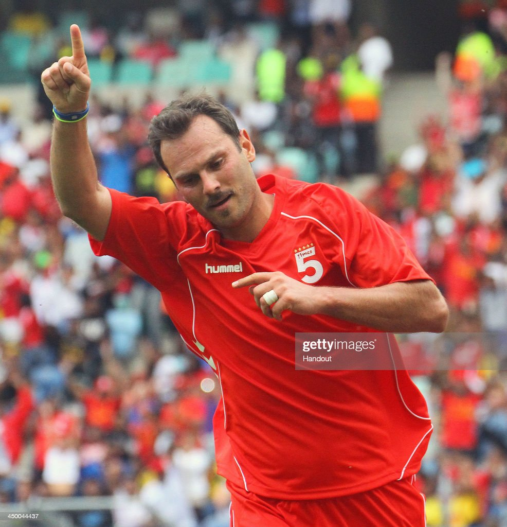 In this handout image provided by the ITM Group, Patrik Berger of Liverpool FC Legends celebrates after scoring his 4th goal during the Legends match between Liverpool FC Legends and Kaizer Chiefs Legends at Moses Mabhida Stadium on November 16, 2013 in Durban, South Africa.