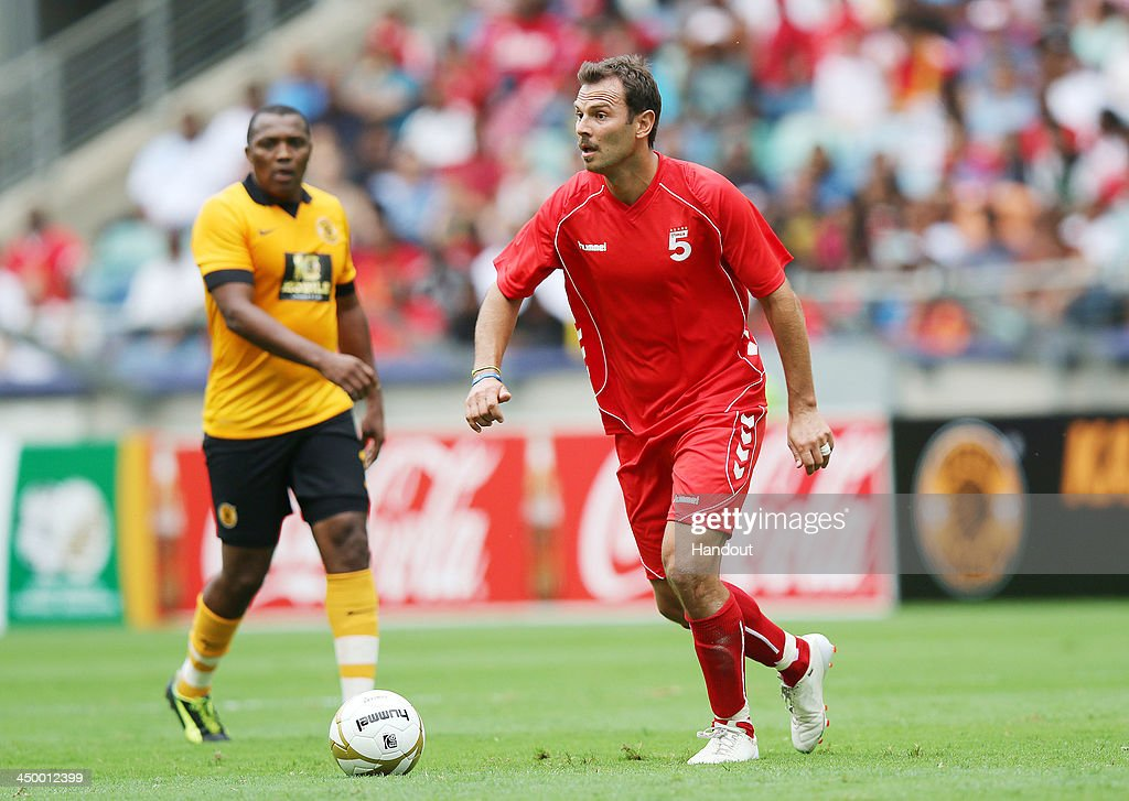 In this handout image provided by the ITM Group, Patrik Berger on the ball during the Legends match between Liverpool FC Legends and Kaizer Chiefs Legends at Moses Mabhida Stadium on November 16, 2013 in Durban, South Africa.