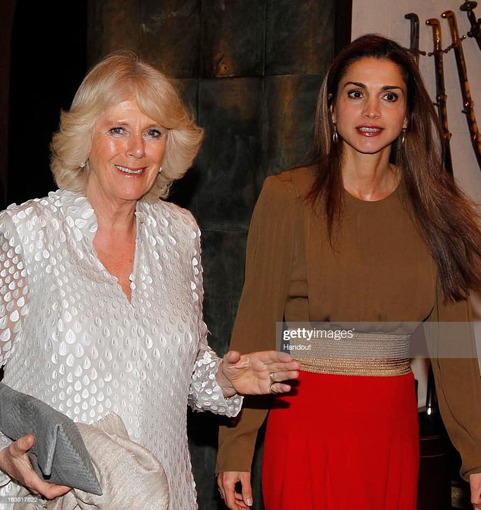 In this handout image provided by the Jordan Royal Household, Camilla, Duchess of Cornwall (L) stands with Queen Rania of Jordan on March 11, 2013 in Amman, Jordan. Prince Charles, the Prince of Wales and Camilla, Duchess of Cornwall are on a nine day tour of the Middle East, during which they are visiting Jordan, Qatar, Saudi Arabia and Oman.