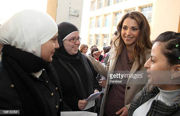 In this handout image provided by the Jordan Royal Household Her Majesty Queen Rania Al Abdullah of Jordan makes a surprise visit to the Sweifieh...