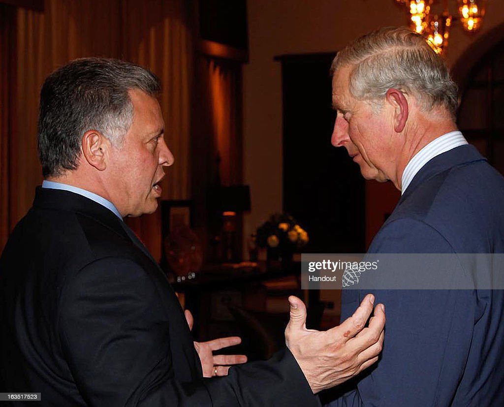 In this handout image provided by the Jordan Royal Household, King Abdullah II of Jordan (L) speaks with Prince Charles, Prince of Wales on March 11, 2013 in Amman, Jordan. Prince Charles, the Prince of Wales and Camilla, Duchess of Cornwall are on a nine day tour of the Middle East, during which they are visiting Jordan, Qatar, Saudi Arabia and Oman.