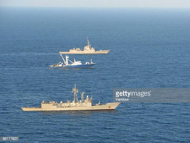 In this handout image provided by the Ministerio de Defensa de Espana Spanish warships the 'Mendez Nunez' and 'Canarias' escort the Alakrana fishing...