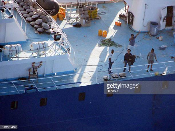 In this handout image provided by the Ministerio de Defensa de Espana men wave aboard the 'Alakrana' fishing vessel on November 17 2009 on route to...