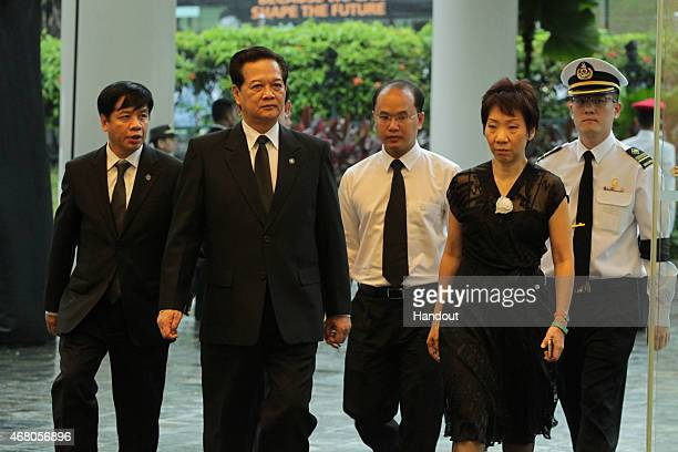 In this handout image provided by the Ministry of Communications and Information of Singapore Prime Minister Nguyen Tan Dung attends the funeral of...