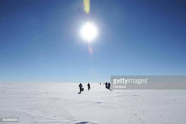 In this handout image provided by the Monaco Palace Prince Albert II of Monaco and team journey to the geographical South Pole on January 14 2009 in...