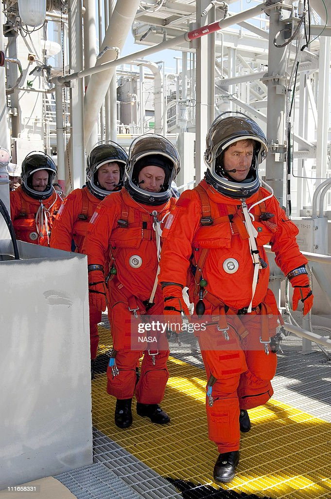 In this handout image provided by the National Aeronautics and Space Administration (NASA), during a simulated pad emergency on Launch Pad 39A, STS-134 Mission Specialists Roberto Vittori, with the European Space Agency, front, and Michael Fincke, Pilot Greg H. Johnson, and Commander <a gi-track='captionPersonalityLinkClicked' href=/galleries/search?phrase=Mark+Kelly+-+Astronaut+and+Gun+Control+Advocate&family=editorial&specificpeople=566699 ng-click='$event.stopPropagation()'>Mark Kelly</a> make their way toward a slidewire basket that would take them to a safe bunker below the pad in an unlikely emergency situation at NASA's Kennedy Space Center on April 1, 2010 in Cape Canaveral, Florida. The emergency training while aboard space shuttle Endeavour is part of a week-long Terminal Countdown Demonstration Test. For the tentative April 29, 2011 launch, Space shuttle Endeavour will deliver the Alpha Magnetic Spectrometer (AMS) and spare parts to the International Space Station (ISS) on its 36th and final scheduled flight before being retired. AMS is designed to operate as an external experiment on the ISS where it will use the unique environment of space to study the universe and its origin by searching for dark matter. The STS-134 crew members are Commander <a gi-track='captionPersonalityLinkClicked' href=/galleries/search?phrase=Mark+Kelly+-+Astronaut+and+Gun+Control+Advocate&family=editorial&specificpeople=566699 ng-click='$event.stopPropagation()'>Mark Kelly</a>, Pilot Gregory H. Johnson and Mission Specialists Michael Fincke, Greg Chamitoff, Andrew Feustel and European Space Agency astronaut Roberto Vittori.