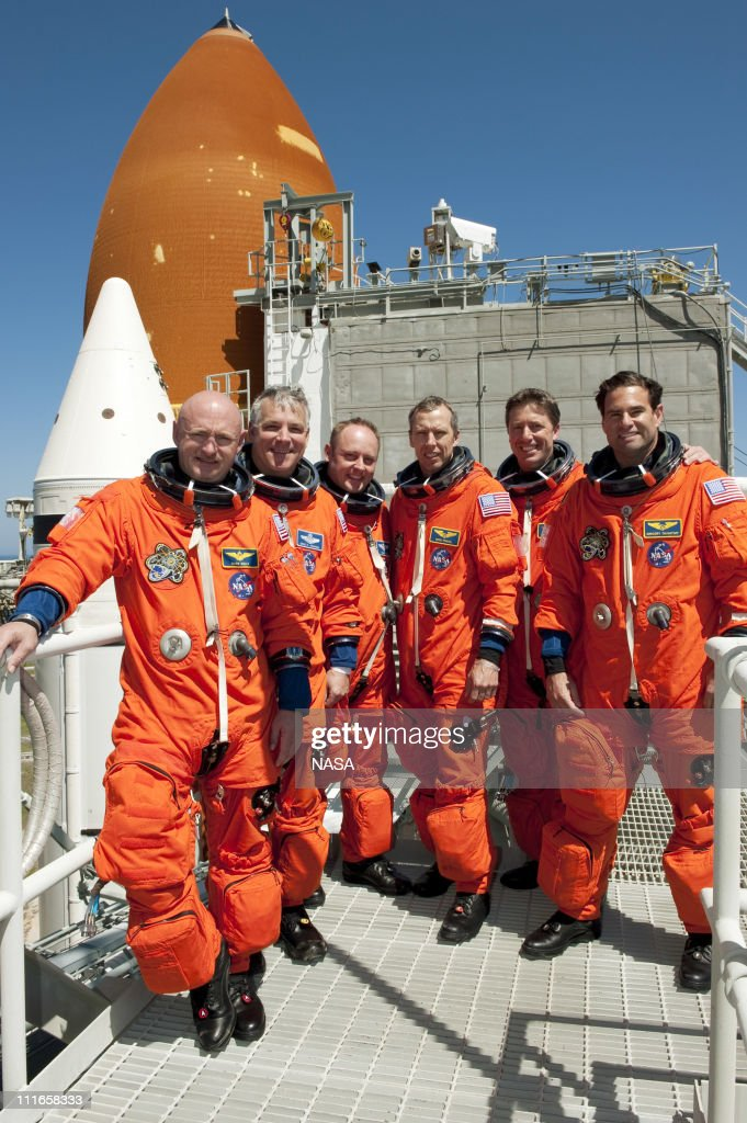 In this handout image provided by the National Aeronautics and Space Administration (NASA), the STS-134 crew takes a break from a simulated launch countdown to take a group photo on the 195-foot level of Launch Pad 39A at NASA's Kennedy Space Center on April 1, 2010 in Cape Canaveral, Florida. For the tentative April 29, 2011 launch, Space shuttle Endeavour will deliver the Alpha Magnetic Spectrometer (AMS) and spare parts to the International Space Station (ISS) on its 36th and final scheduled flight before being retired. AMS is designed to operate as an external experiment on the ISS where it will use the unique environment of space to study the universe and its origin by searching for dark matter. The STS-134 crew members are Commander <a gi-track='captionPersonalityLinkClicked' href=/galleries/search?phrase=Mark+Kelly+-+Astronaut+and+Gun+Control+Advocate&family=editorial&specificpeople=566699 ng-click='$event.stopPropagation()'>Mark Kelly</a>, Pilot Gregory H. Johnson and Mission Specialists Michael Fincke, Greg Chamitoff, Andrew Feustel and European Space Agency astronaut Roberto Vittori.