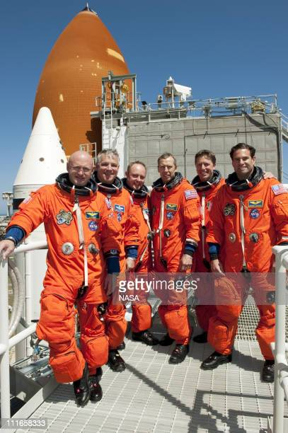 In this handout image provided by the National Aeronautics and Space Administration the STS134 crew takes a break from a simulated launch countdown...