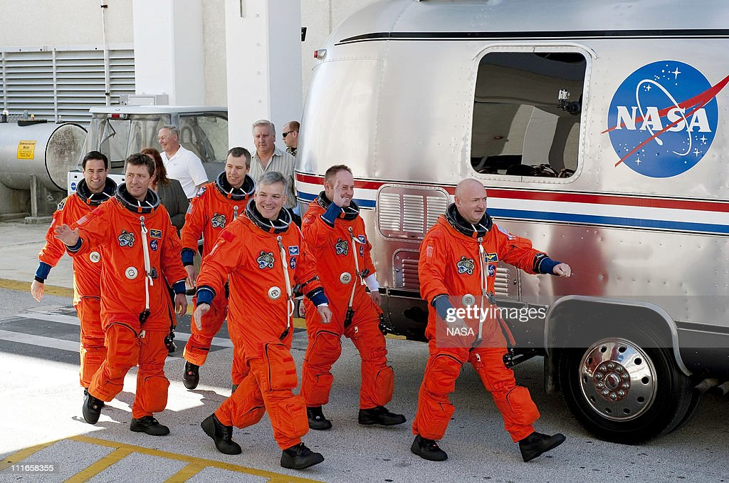 In this handout image provided by the National Aeronautics and Space Administration (NASA), during a simulated launch countdown, the STS-134 crew (R-L) Commander <a gi-track='captionPersonalityLinkClicked' href=/galleries/search?phrase=Mark+Kelly+-+Astronaut+and+Gun+Control+Advocate&family=editorial&specificpeople=566699 ng-click='$event.stopPropagation()'>Mark Kelly</a>, Mission Specialist Mike Fincke, Pilot Greg H. Johnson, Roberto Vittori, European Space Agency astronaut, and Mission Specialists Andrew Feustel and Greg Chamitoff walk out of the Operations and Checkout Building to the waiting Astrovan at NASA's Kennedy Space Center on April 1, 2010 in Cape Canaveral, Florida. As part of the Terminal Countdown Demonstration Test, the crew members ride to Kennedy's Launch Pad 39A in the silver vehicle and strap into space shuttle Endeavour to practice the steps that will be taken on launch day. For the tentative April 29, 2011 launch, Space shuttle Endeavour will deliver the Alpha Magnetic Spectrometer (AMS) and spare parts to the International Space Station (ISS) on its 36th and final scheduled flight before being retired. AMS is designed to operate as an external experiment on the ISS where it will use the unique environment of space to study the universe and its origin by searching for dark matter.