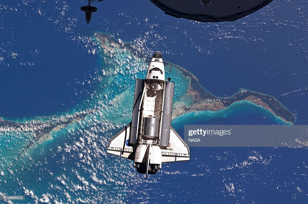In this handout image provided by the National Aeronautics and Space Administration NASA space shuttle Atlantis in Earth orbit seen over the Bahamas...