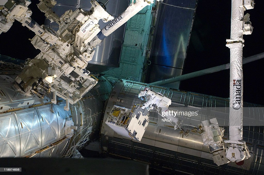 In this handout image provided by the National Aeronautics and Space Administration (NASA), NASA astronaut Ronald Garan attached to the robotic arm Canadarm2 moves a failed ammonia pump module from a storage platform on the International Space Station to the cargo bay of the space shuttle Atlantis during a planned six-and-a-half-hour spacewalk July 12, 2011 in space. This is the 160th spacewalk devoted to station assembly and maintenance since construction began in 1998. Space shuttle Atlantis has embarked on a 12-day mission to the International Space Station where it will deliver the Raffaello multi-purpose logistics module packed with supplies and spare parts. This will be the final launch of the space shuttle program, which began on April 12, 1981 with the launch of Colombia.